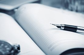 Close-up View Of Fountain Pen On Paper Notebook