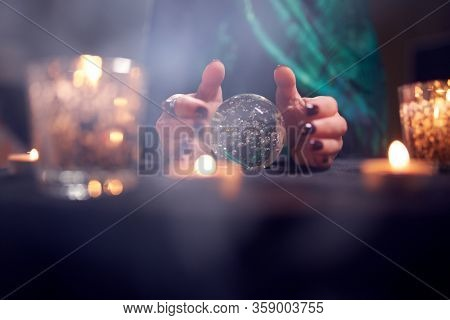 Close-up of fortuneteller woman's hands with predictions ball
