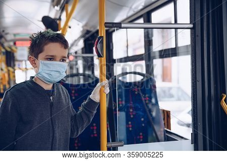 Child Boy Wearing Medical Protective Mask In Public Transport Bus.