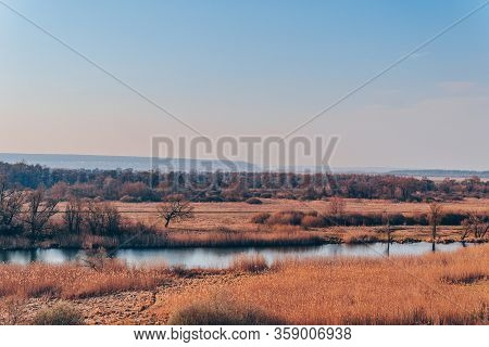A Quiet River In A Green Rural Area. Beautiful Landscape With A River With Calm Water, Located Next