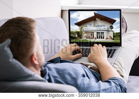 Online House And Real Estate Property Search On Laptop