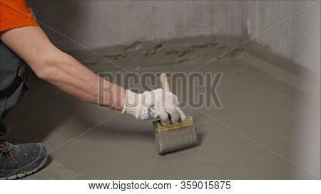The Process Of Applying Mortar - Waterproofing To A Concrete Floor. The Concept Of Waterproofing The