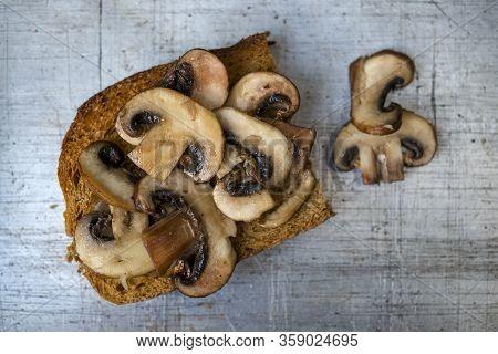 Mushrooms On Toast Servings On Worn Aluminum Background Overhead View