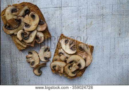 Mushrooms On Toast Servings On Worn Aluminum Surface Overhead View Copy Space