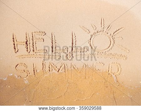 Close Up View On Yellow Sand With Inscription Written By Finger. Red Sea Beach In February. Texture