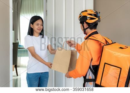 Asian Man Courier On Bicycle Delivering Food In Orange Uniform Smile And Holding Food Bag In Front H
