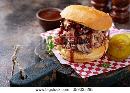 Bbq Smoked Pulled Pork Sandwich With Pickles And Barbeque Sauce