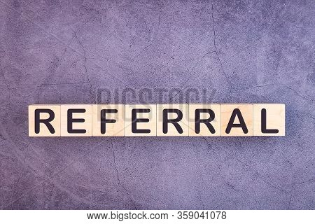 Referral Word Made With Wood Building Blocks.