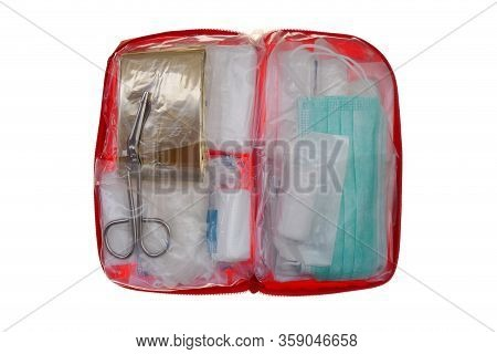 First Aid Kit Isolated On White Background.first Aid For Coronavirus.red First-aid Kit Open With Mas