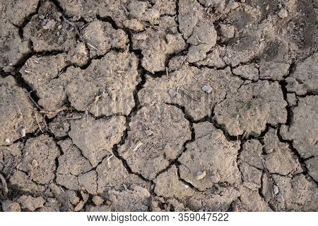 Cracked Earth, Cracked Soil. Texture Of Grungy Dry Cracking Parched Earth. Global Warming Effect.