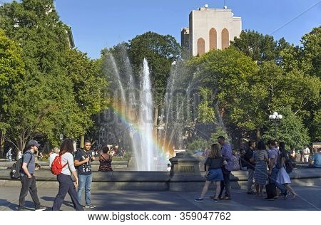 New York, New York/usa - June 29, 2018: People Visit Washington Square Park On A Sunny Day.