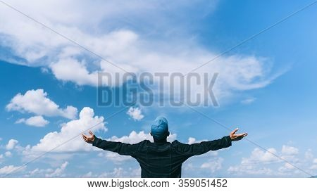 Copy Space Of Silhouette Man Rising Hands With Sun Light And Blue Sky White Clouds Abstract Backgrou