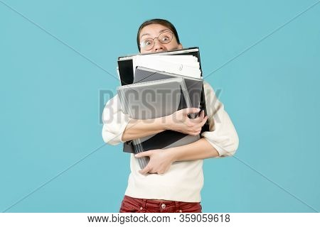 A Young Woman And A Large Number Of Work Documents. Busy Office Worker