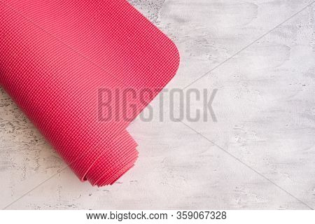 Yoga Mat On White Concrete Background. Concept For Doing Hatha Yoga. Copy Space.