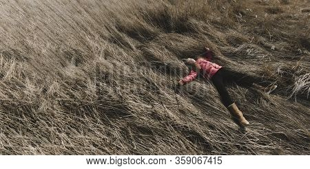 Young Teenager Girl With Blond Hair And Smile On Face Lying On Wheat Field. Nature Background. Happi