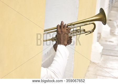 Detail Of Hands Of Cuban Musician Playing Trumpet In Colorful Street Of Havana, Cuba