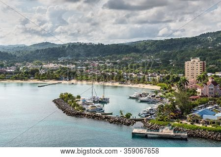 Ocho Rios, Jamaica - April 22, 2019: Coastline View With Ocho Rios Bay Beach And Marina, In The Trop