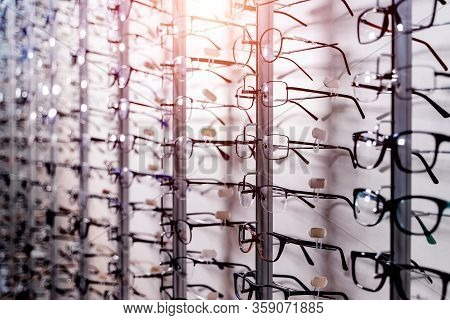 Row Of Glasses At An Opticians. Eyeglasses Shop. Stand With Glasses In The Store Of Optics. Showcase