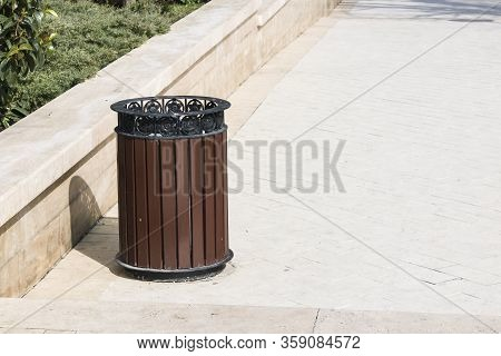 Garbage Containers Used For Collecting Solid Household Waste. Trash Bins Installed On The Streets Of