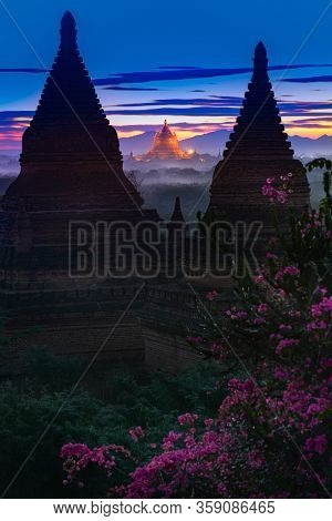 Bagan Myanmar Golden Temple Between Two Bell-shaped Pagodas After Sunset