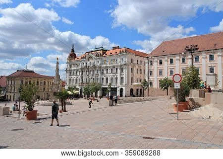Pecs, Hungary - August 12, 2012: People Visit Old Town Of Pecs, Hungary. Pecs Is 5th Largest City In