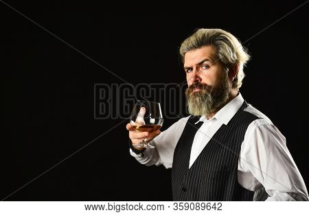 Barman Tasting Red Wine At Degustation. Male Sommelier Appreciating Drink. Glass Of Red Wine. Barten