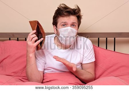 Unemployed Sad Man In Medical Mask And Suit Showing Empty Wallet