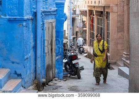 Jodhpur, India - December 9, 2019: A Woman In Traditional Clothes Walking In An Alley.