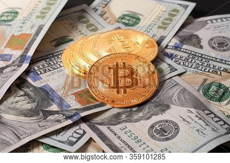 An Alternative Currency For Storing Funds In The Form Of Bitcoins. Golden Cryptocurrency Coins On A
