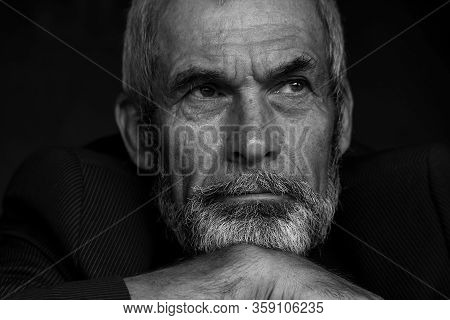 Fabulous At Any Age Concept. Close Up Portrait Of Handsome Mature Man With Beard And Moustache. Mono