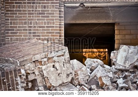 Fallen Rubble From A Brick Building Under Demolition