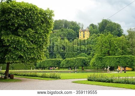 Salzburg, Austria - May 28, 2019: The Hellbrunn Museum Is Perched High Above The Estate With Its Man