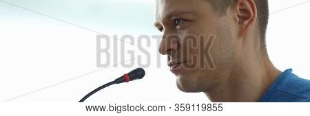 Man Speaks In Front Microphone, Informal Meeting. Speaker Presents Material At Seminar Or Training.