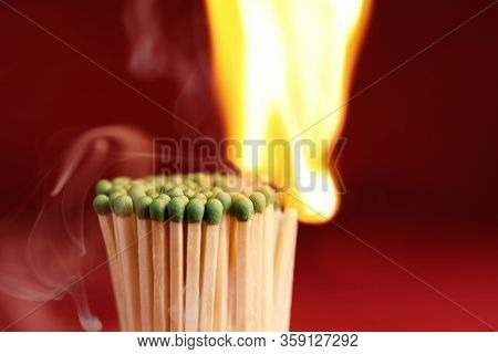 Group Of Burning Matchsticks On Red Background, Closeup