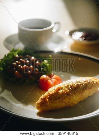 Omlete On Dish With Vegatable As Macro