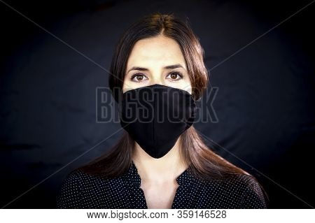 Young Woman Wearing A Protective Black Leather Face Mask During The Coronavirus Disease Covid-19 Out