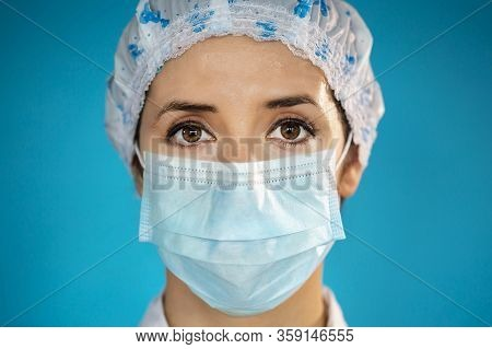 Nurse With Blue Protective Medical Cap And Surgical Face Mask During The Coronavirus Disease Covid-1