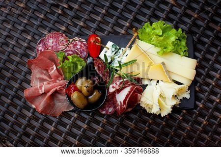 Meat And Cheese Appetizer With Pickled Olives And Lettuce Leaves. Cold Appetizers, Gourmet Lunch. Th