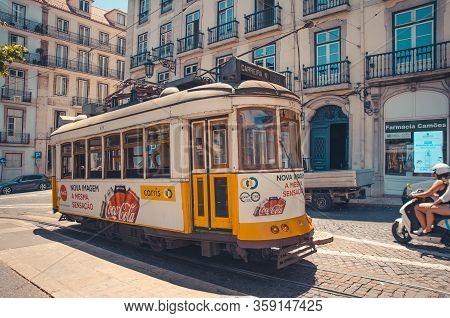 Lisbon, Portugal - June 15, 2017: Famous Yellow Tram 28 In Lisboa On Largo Lu S De Camoes Square
