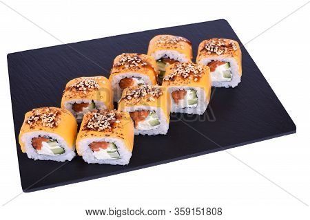 Traditional Fresh Japanese Sushi Rolls On A Black Stone Dragon Cheeses On A White Background. Roll I