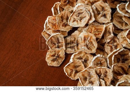 Homemade Dehydrated Banana Chips. Dehydrated Slices Of Bananas. Healthy Food. Healthy Snack