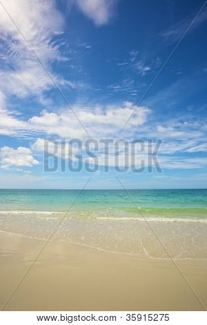 beach and tropical sea under the bright blue sky at summer day