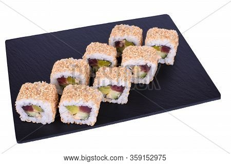 Traditional Fresh Japanese Sushi Rolls On A Black Stone Theca Spicy On A White Background. Roll Ingr