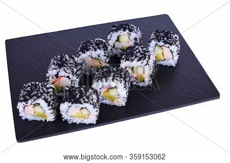 Traditional Fresh Japanese Sushi Rolls On A Black Stone Hokaido On A White Background. Roll Ingredie