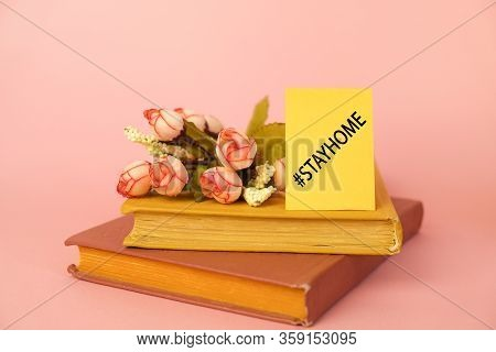 Stay At Home Concept. Coronavirus Quarantine. Self - Isolation. Books, Flowers And Card With Hashtag