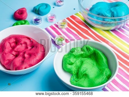 Homemade Plasticine, Plasticine, Play Dough On A Colored Background With Glitters. Molding Clay Or S