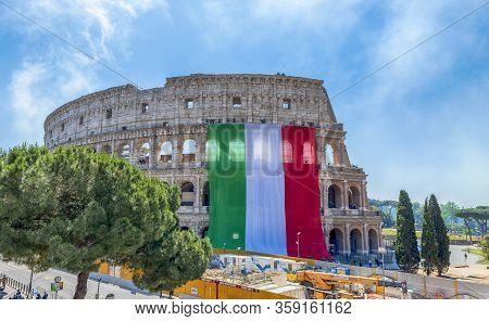 Rome, Italy - June 2, 2019: Colosseum Dressed In The Tricolor Flag Of Italy On Republic Day In Rome,