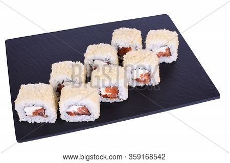 Traditional Fresh Japanese Sushi Rolls On A Black Stone Caesar With Salmon Roll On A White Backgroun