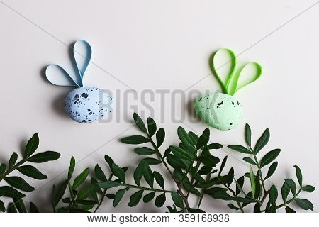 Colorful Easter Eggs In The Rattan Nest And Flying Creative Bees.colorful Easter Eggs In The Rattan