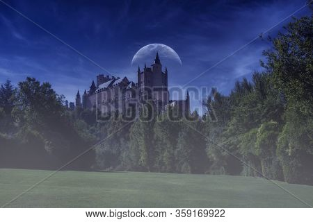 Alcazar De Segovia, Old Medieval Palace In Segovia, Spain. Night Shot In The Blue Hour With Moon.
